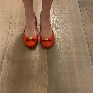 Ladies Tory Burch plastic slip ons orange